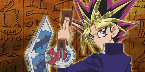 the anime character from yugioh holding cards
